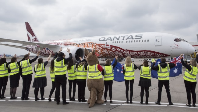 Qantas staff farewell the plane making its maiden journey. (Photo by James D. Morgan/Getty Images)