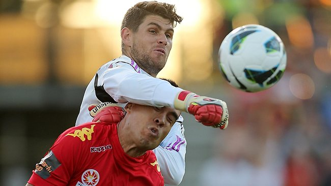 Victory keeper Nathan Coe punches the ball clear from Adelaide's Iain Ramsay during a match. Picture: Morne de Klerk