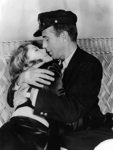 Lauren Bacall is embraced by Humphrey Bogart in a scene from the film 'To Have And Have Not', 1944. Picture: Getty