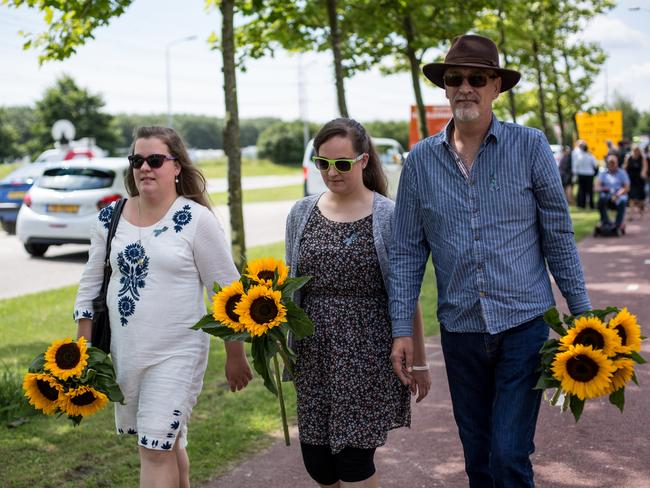 Relatives of MH17 victims flowers as they arrive at a service to mark the three-year anniversary of the downing of the plane. Picture: Franck Bessiere
