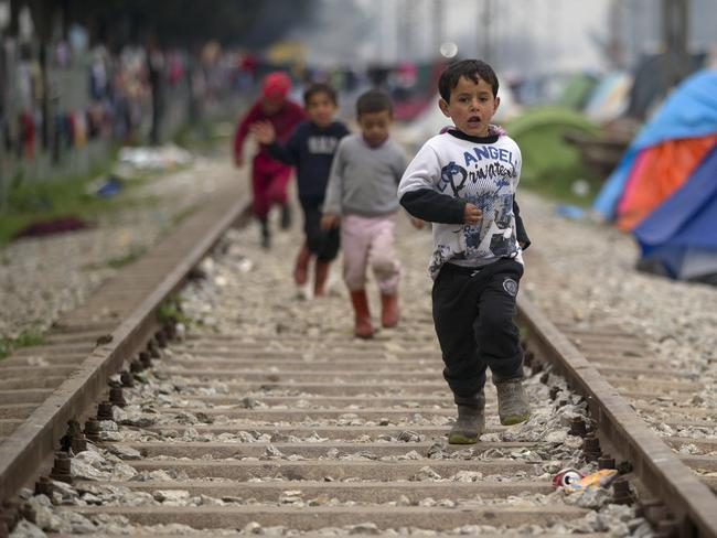 Children at the northern Greek border point of Idomeni, Greece. Charity groups say plans to return refugees make a mockery of human rights. Picture: AP Photo/Vadim Ghirda