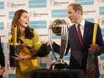 Prince William, Duke of Cambridge and Catherine, Duchess of Cambridge hold cricket bats presented to them in front of the Cricket World Cup during a reception at the Sydney Opera House. Picture: Getty/Pool
