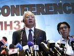 Malaysian Prime Minister Najib Razak, left and director general of the Malaysian Department of Civil Aviation, Azharuddin Abdul Rahman, delivers a statement to the media regarding the missing Malaysia Airlines jetliner MH370. Picture: AP/Wong Maye-E