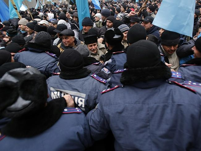 Minority voice ... Crimean Tatars clash with police in front of a local government buildi