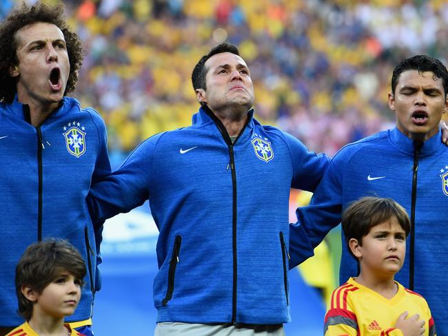 Brazil stars David Luiz (L), Julio Cesar and Thiago Silva (R) sing the national anthem before the 2014 FIFA World Cup Brazil Group A match against Croatia.