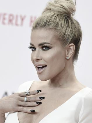 Carmen Electra briefly dated Simon Cowell. Picture: AP