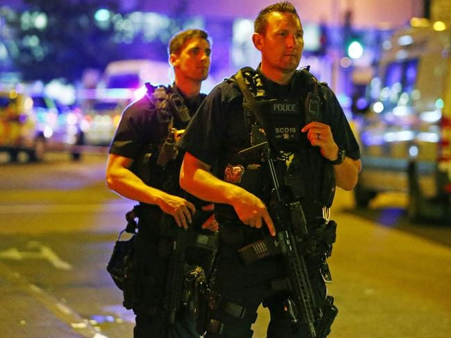 Armed police officers attend to the scene in the Finsbury Park neighbourhood of North London. Picture: REUTERS/Neil Hall