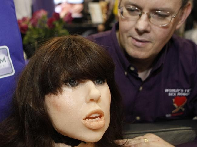 Douglas Hines, founder of True Companion, poses with a life-size rubber doll named Roxxxy during the Adult Entertainment Expo in Las Vegas, Nevada, 09/01/2010.