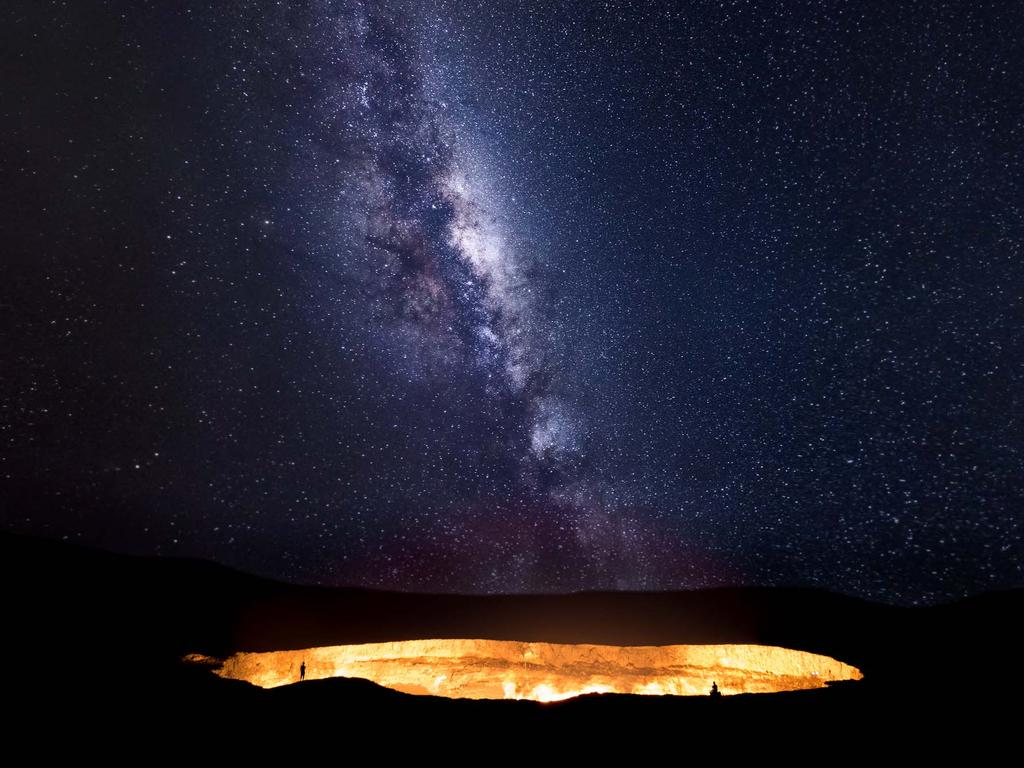 """Heaven meets hell as the milky way ascends over the Darvaza gas crater in the Karakom desert, Turkministan."" Picture: Tino Solomon, UK, Shortlist, Open Low Light, 2016 Sony World Photography Awards"
