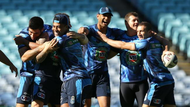 Michael Jennings and team mates enjoying themselves during the NSW Blues Origin team captains run training. Picture Gregg Porteous