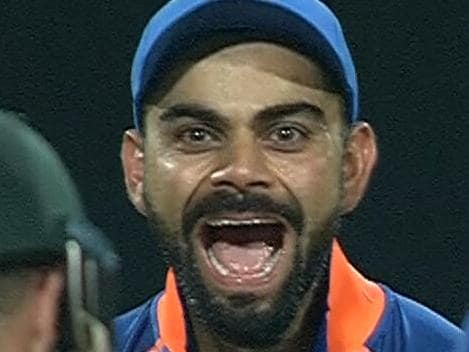Virat Kohli celebrates the dismissal of Matthew Wade.