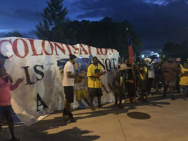 Indigenous activists displayed signs reading 'Stolenwealth Games' and 'Colonisation is not a Game' as they protested for Aboriginal rights. Picture: Britt Ramsey