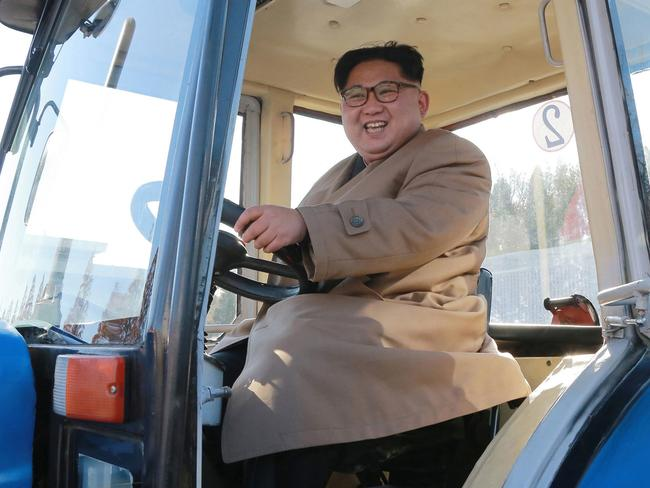 North Korean leader Kim Jong Un sits in a tractor at the Kumsong Tractor Factory, in Nampo, North Korea. Picture: AP.