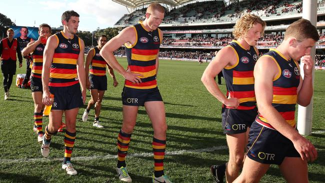 Adelaide players walk off the Oval after heavy loss to West Coast. Picture: Sarah Reed