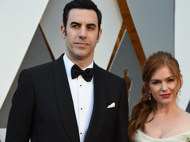 Happy ... Baron Cohen walked the red carpet with Aussie actress wife, Isla Fisher — who helped him smuggle his Ali G costume into the event. Picture: AFP/Valerie Macon