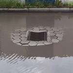 This storm drain couldn't have been put in a worse place if the designer had tried.