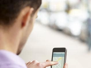Generic image of smartphone iPhone user. A young man looking for directions on an smart phone.