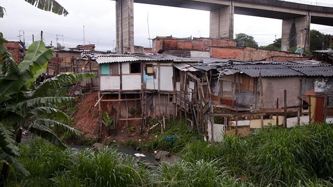 This slum, the Favela da Paz, is where 14-year-old Poliana works as a prostitute with men from the neighbouring World Cup stadium site. Picture: Jota Roxo