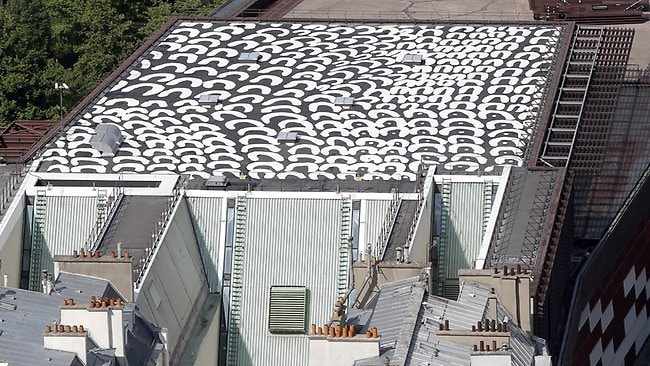 The huge 700m squared black and white painting by Aboriginal artist Lena Nyadbi, on top of the Quai Branly Museum, as seen from the Eiffel Tower in Paris.