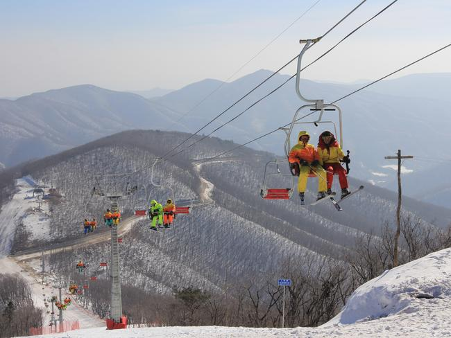 North Korean students ride a chair lift at the Masik ski resort in 2014 near Wonsan in northeastern North Korea. Picture: Jean H. Lee/Getty Images