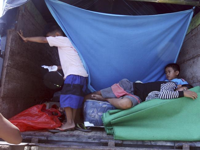 Children stay in a truck as their temporary shelter in Klungkung, Bali. Picture: AP