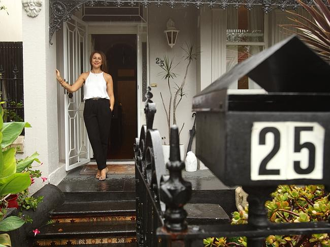 Dionysia Kalisperis outside 25 Allen St, Glebe, which sold for $1.49 million. Picture: Carly Earl