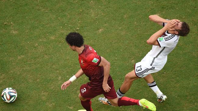 Germany's forward Thomas Mueller (R) reacts after an incident with Portugal's defender Pepe (L).