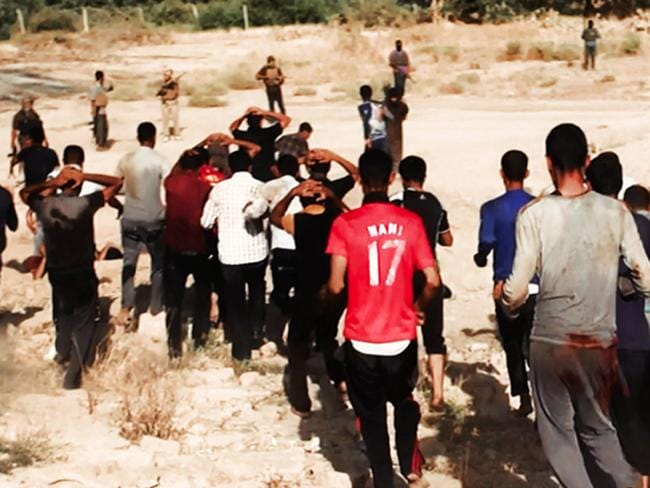 Killing fields ... This image posted on a militant website appears to show militants leading captured Iraqi soldiers wearing plain clothes to an open field moments before shooting them in Tikrit, Iraq.