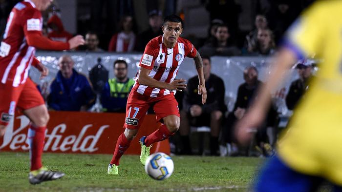 Tim Cahill of Melbourne City (centre) in action during their Round of 16 FFA Cup match against the Brisbane Strikers at Perry Park in Brisbane, Wednesday, Aug. 24, 2016. (AAP Image/Dan Peled) NO ARCHIVING, EDITORIAL USE ONLY
