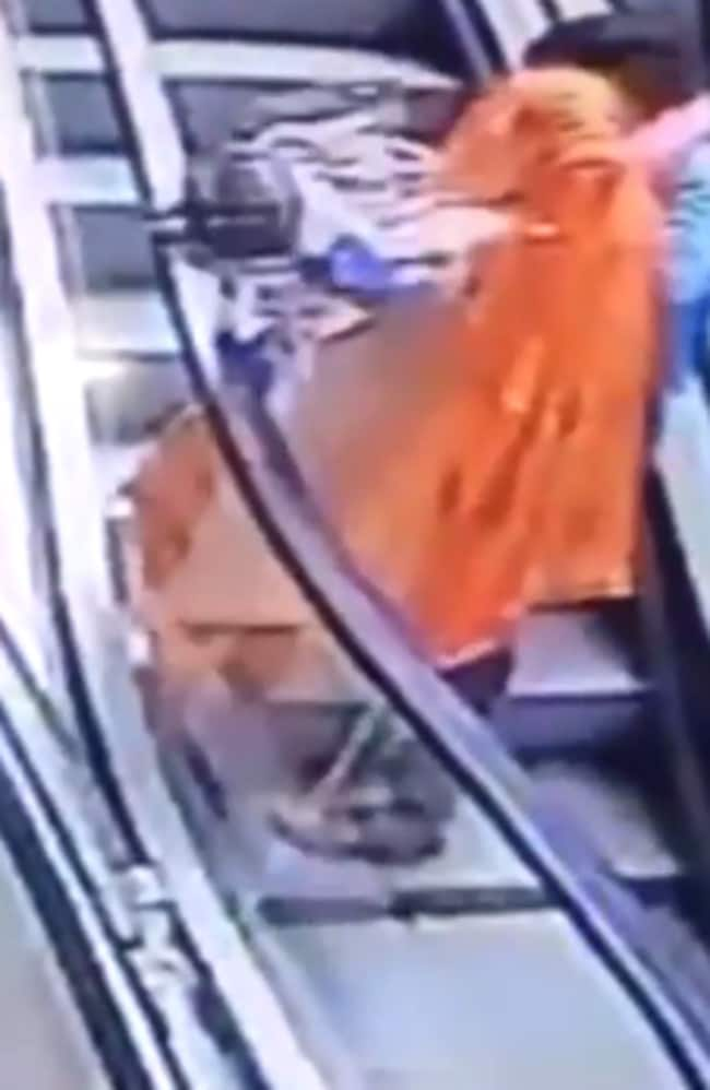 The mum was travelling up to the third floor of the CGR Mall escalator at Ganganagar in Rajasthan, India, when the baby slipped from her grasp.