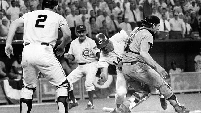 Cincinnati Reds' Pete Rose (14) slams into Cleveland Indians' catcher Ray Fosse to score a controversial game-winning run for...