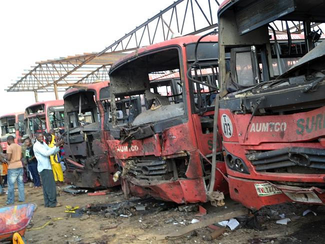 Destroyed ... Burnt buses after twin attacks at a bus stop packed with commuters in Abuja. Picture: AP