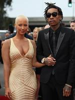 Model Amber Rose and musical artist Wiz Khalifa featured wearing Converse in support of the GRAMMY Foundation's GRAMMY Camp attend the 56th GRAMMY Awards at Staples Center iin Los Angeles, California. Picture: Getty