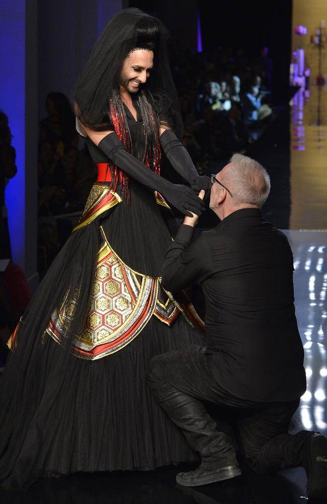 Jean Paul Gaultier with Austrian singer and Eurovision Song Contest 2014 winner Conchita Wurst at the end of his 2014/2015 Haute Couture Fall-Winter collection fashion show. Picture: MIGUEL MEDINA