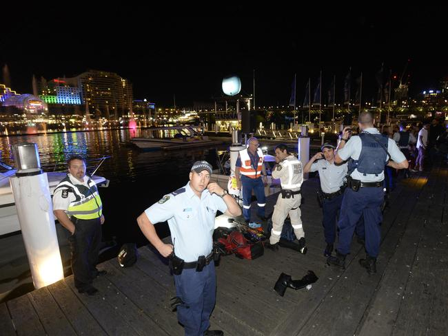 Police at the spot where the man fell. Picture: Gordon McComiskie