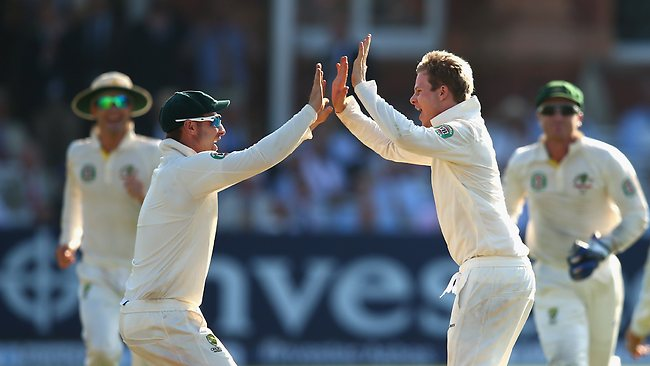 Steve Smith (R) and Phil Hughes celebrate the wicket of Jonny Bairstow.