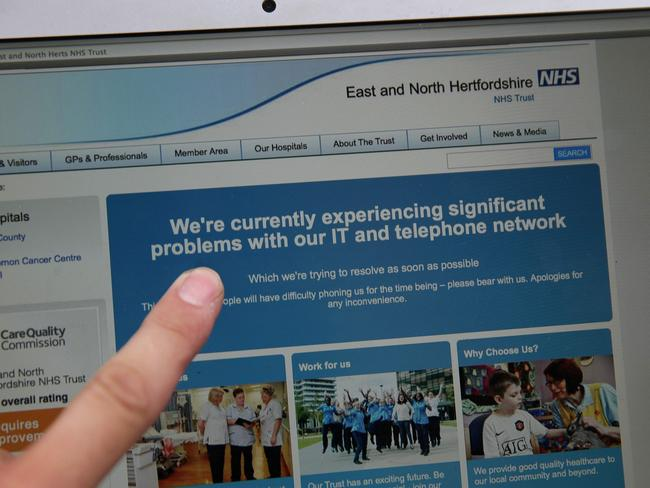 "A screengrab taken from the website of the East and North Hertfordshire NHS alerting the public of ""problems with our IT and telephone network"". Picture: AFP/Daniel Leal-Olivas"