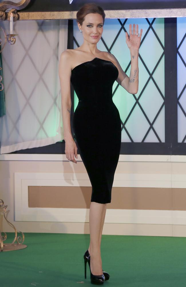 "Angelina Jolie poses for photographers during the Japan premiere of ""Maleficent""."