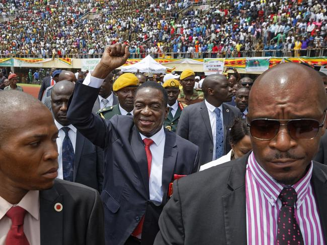 Emmerson Mnangagwa, centre, arrives at the presidential inauguration ceremony in the capital Harare, Zimbabwe. Picture: AP