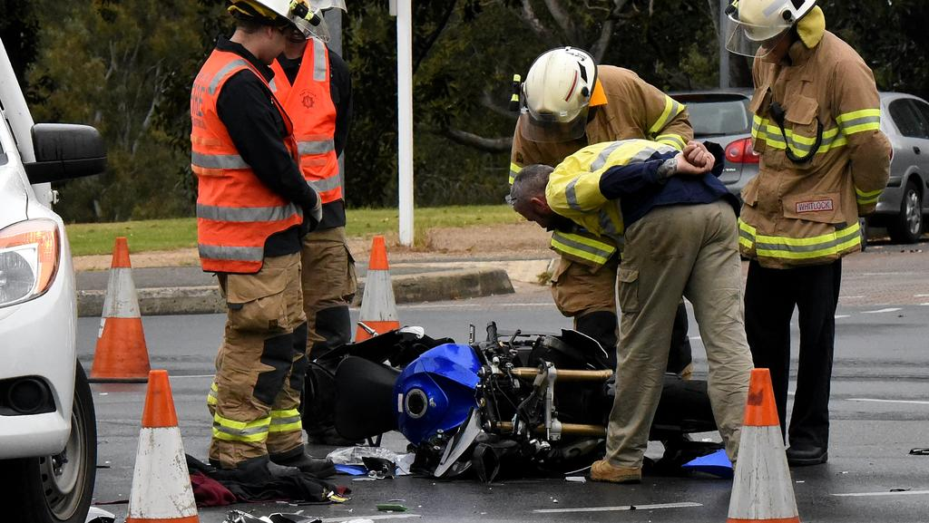 Emergency services inspect the smashed bike on Jeffcott St at North Adelaide. Picture: Bernard Humphreys.