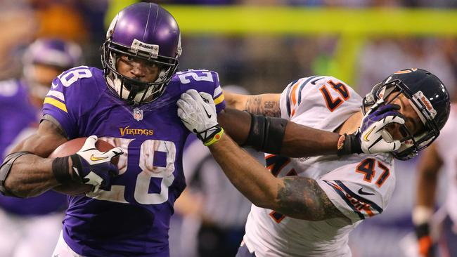 Adrian Peterson #28 of the Minnesota Vikings put up the 'don't argue'.