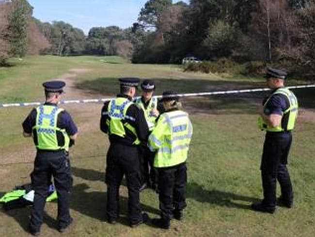 Police at The Club at Meyrick Park golf course where Mr Sliachtecov's body is thought to have been sitting in a tree for three years.