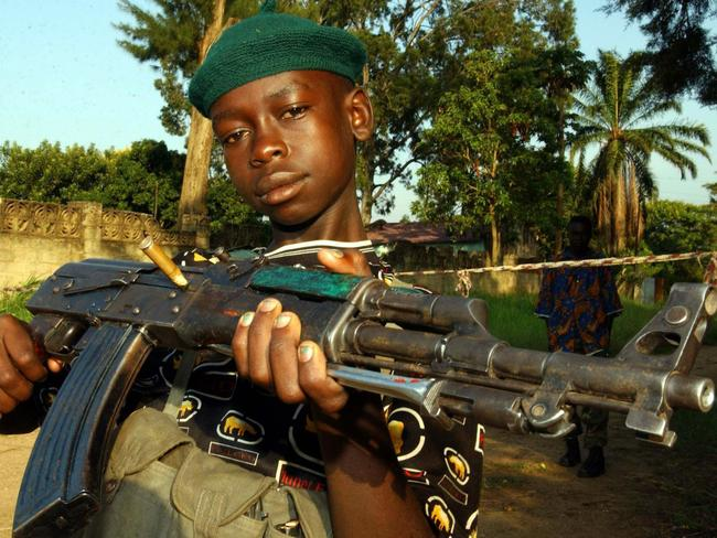 Trained to kill ... a child soldier in the Democratic Republic of Congo in 2003.
