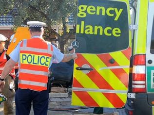 SA road accident scene - Holden Commodore utility collided with truck at Mooringe Avenue in North Plympton - man cut from his vehicle after colliding with truck is put into ambulance.