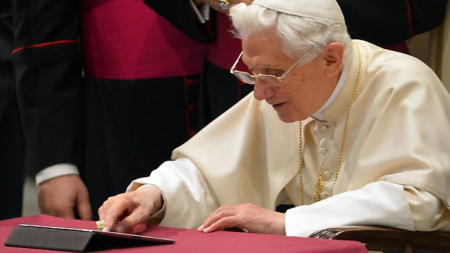 Pope Benedict XVI clicks on a tablet to send his first twitter message from the Vatican.