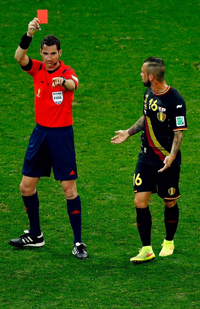Australian referee Ben Williams sends off Belgian star Steven Defour.