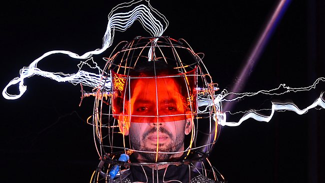 "US Magician David Blaine looks out from his conductive suit as lightning dances about his body during his latest performance, ""Electrified"", in New York. Picture: Emmanuel Dunand"