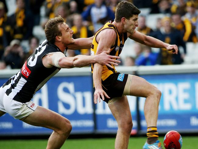 Breust kicks a goal in front of Collingwood's Lachlan Keeffe. Picture: Colleen Petch