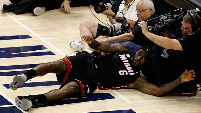 LeBron James of the Miami Heat falls into photographers and cameramen during Game Four of the Eastern Conference Finals against Indiana. Picture: Joe Robbins
