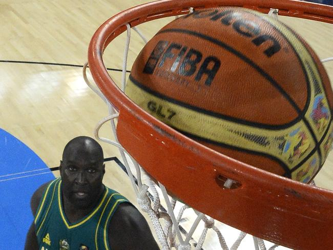 Australia's centre Nate Jawai watches his shot go through the ring.
